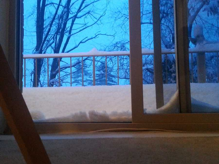 Snow piles up against the patio door in Sykesville