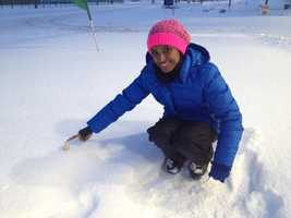 11 News meteorologist Miri Marshall plays in the snow in Timonium, Baltimore County.
