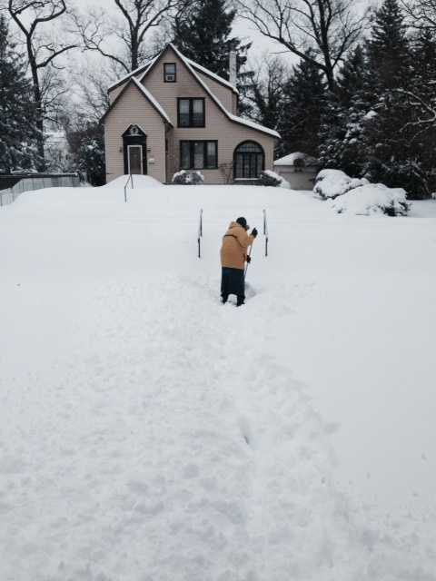 Shirley in Lochearn, Md. shoveled in a skirt.