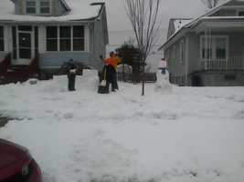 """Sharon from Violetville snapped a photo of her neighbors and their kids building a snow fort and said """"it brought back such wonderful memories perhaps it will do the same for your other viewers."""""""