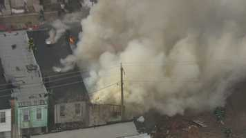 A large fire consumes a rowhouse in east Baltimore.