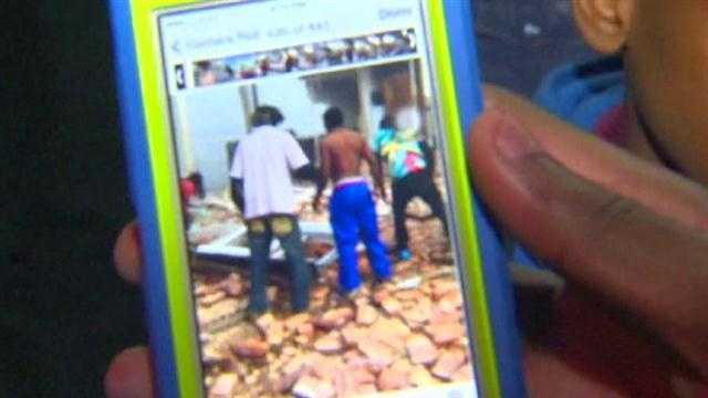 Video shows neighbors sifting through the rubble to try to look for more survivors.