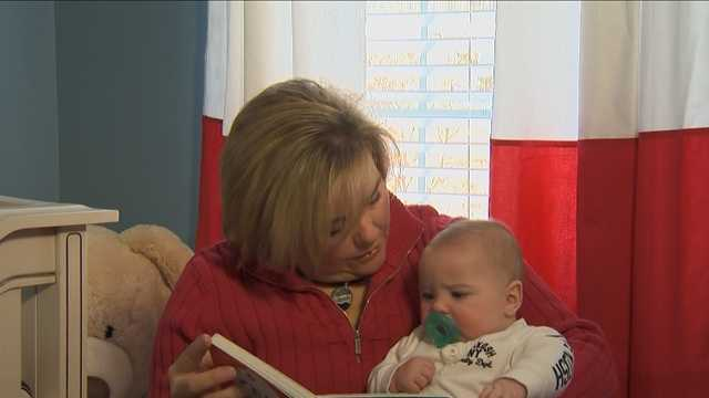 Karen Arnaiz, 45, reads to her newborn son, Jimmy.