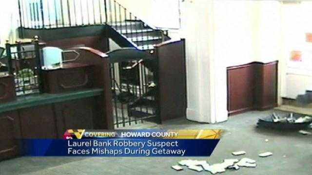 Surveillance video shows Robert Williams dropping cash while trying to make his escape from the bank.
