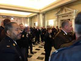 Feb. 25: Law enforcement members pack the State House hallways to oppose marijuana reform bills that are being heard.