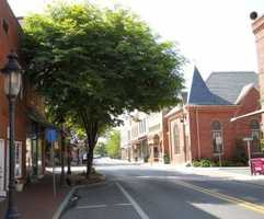 """The town that served as backdrop to movies """"Tuck Everlasting"""" and """"The Runaway Bride"""" has a population of more than 4,500."""
