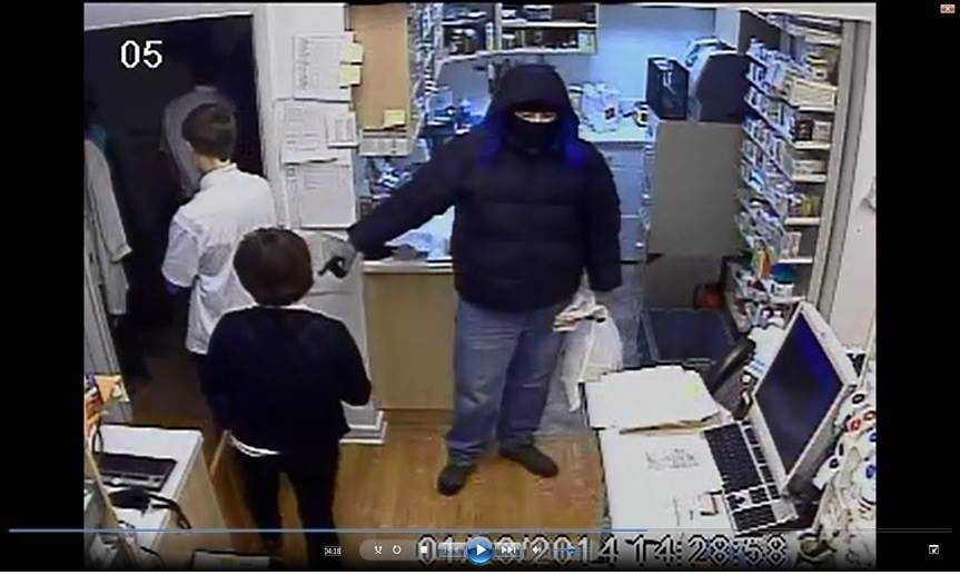 Police investigating the armed robbery of the Ellicott City Pharmacy in January have released surveillance photos.