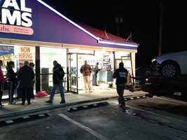 A car drove through a convenience store in Towson, pinning a customer against a counter, police said.