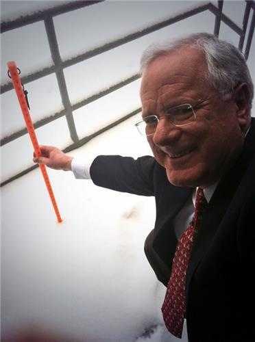 11 Insta-Weather PLUS meteorologist John Collins measuring the snow on TV Hill