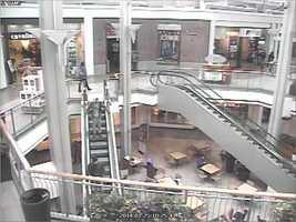 Suspect down escalator