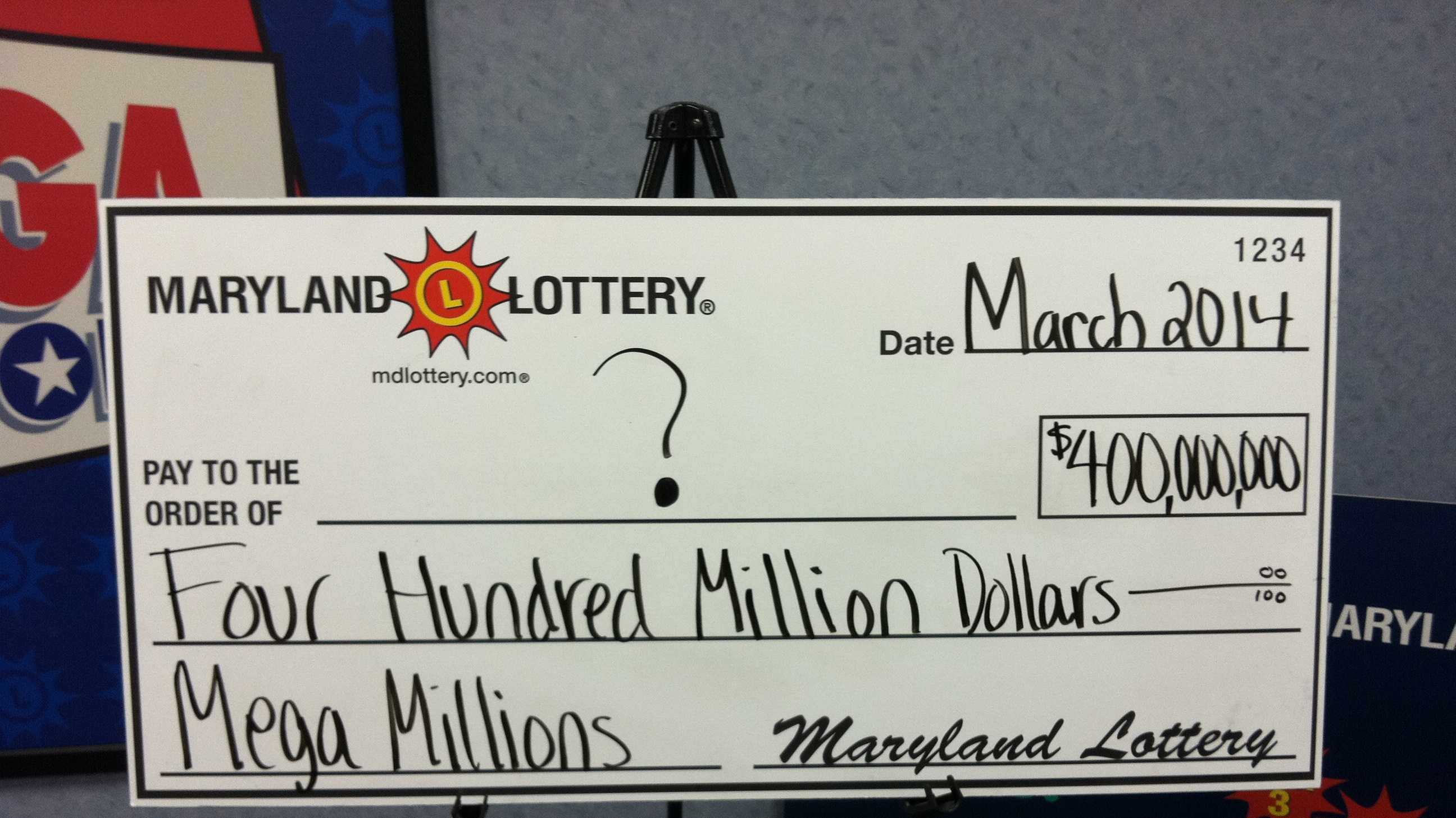 The Maryland Lottery draws up a mock check for the co-winner of Tuesday night's $400 million Mega Millions jackpot.