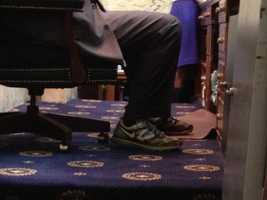 March 26: House Speaker Michael Busch prepares for a long day taking up the state budget by wearing his sneakers.