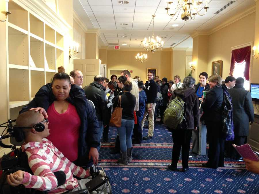 March 26: Direct care workers clients families pack hearing room and hallways as Finance Committee hears minimum wage bill.