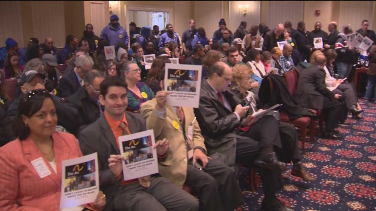 Hundreds of people converge on Annapolis, urging Gov. Martin O'Malley to find the money to keep caregivers of the developmentally disabled on the job.