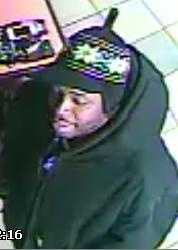 Police said one of the men was wearing a black beanie cap with a brim and a white snowflake pattern.