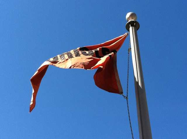 The Orioles flag on the flag court whipping in the wind on Opening Day