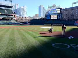 The Orioles grounds crew manicuring the field on Opening Day morning at the ballpark