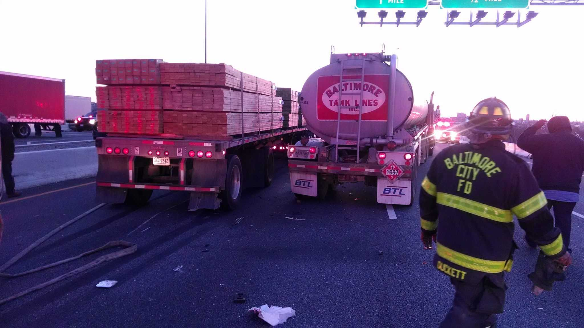 Fire crews work to clear two rigs involved in a crash on I-95 northbound near Caton Avenue early Tuesday morning.
