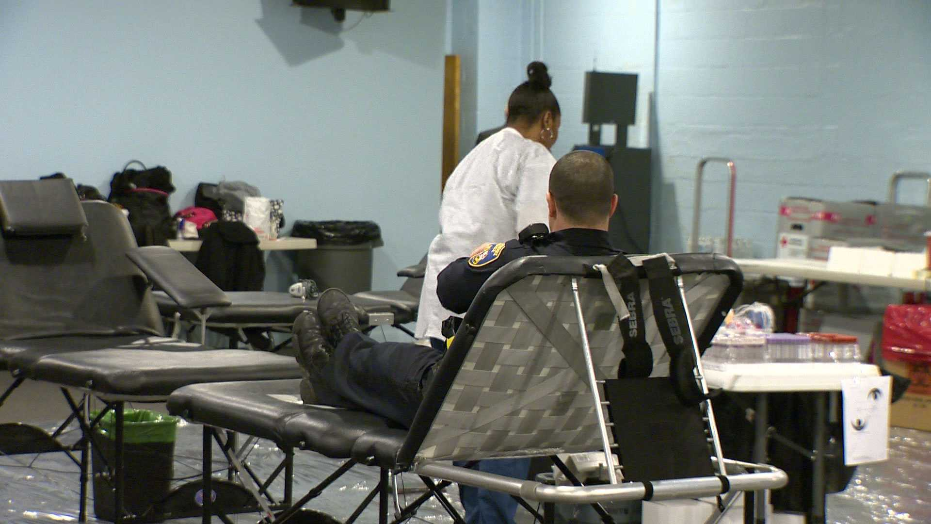 An officer donates blood during a drive in honor of Baltimore Police Sgt. Keith McNeill, who was shot several times while off duty in March.