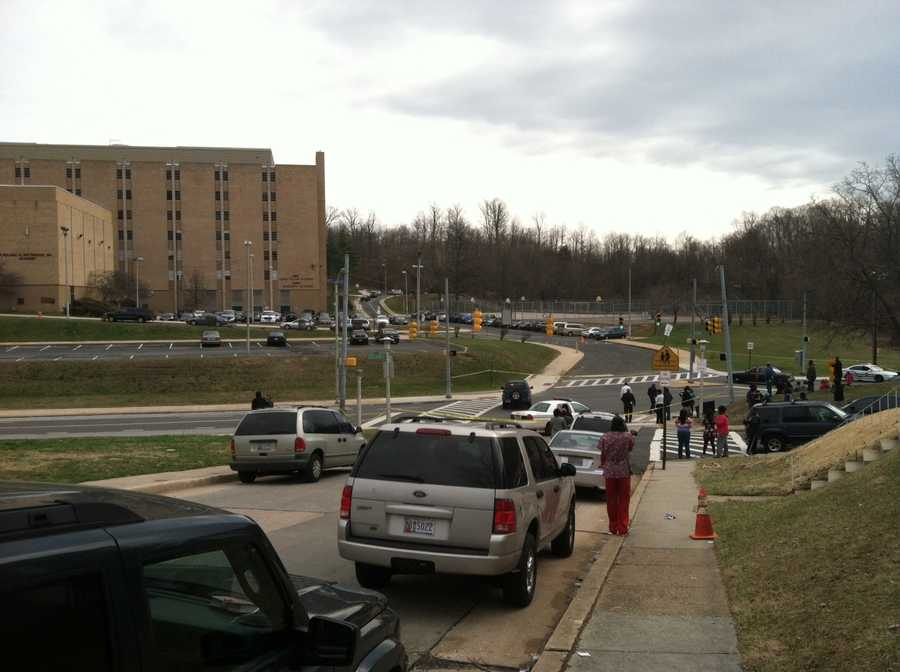 While a police SWAT team sweeps the school as a precaution, parents lined up at nearby Baltimore Polytechnic Institute to meet with their children as word of student evacuations came down.