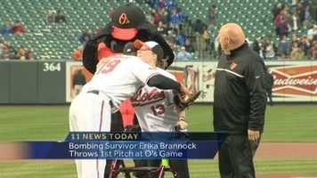 Brannock threw out the ceremonial first pitch at the game between the O's and the Boston Red Sox.