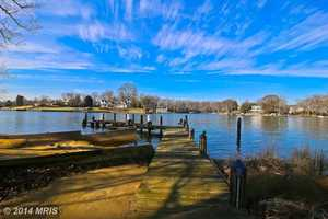 The home features a serene setting with eastern views of The Chesapeake Bay, western facing guest house and protected deep water dock on Burley Creek.