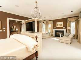 A luxurious master suite with stately dressing rooms and spa bath are also featured in the home.