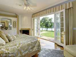 An expansive sunroom and open great room with cherry paneling, luxurious master bedroom suite with onyx accents also enhances the home.