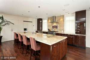 The home also has a gourmet kitchen, home theater, sauna, walls of glass and a five-stop elevator.