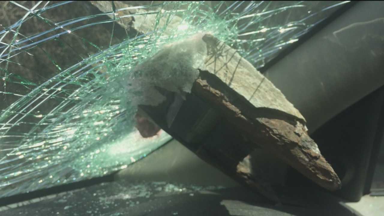 Errant highway deflector damages woman's car