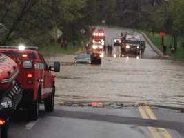 Swift water rescue on Milford Mill Road at Scott's Hill Road
