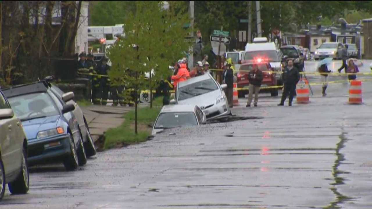 Cars fall into landslide in Charles Village