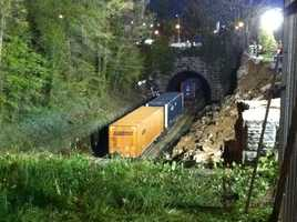 CSX trains begin to move again through the collapse area around 5:30 a.m. Friday.