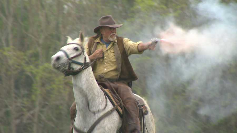 """""""The next couple of days, we're going to play cowboys,"""" said Chip Ridgely of Rockin R Western Productions as cowboy mounted shooting is demonstrated."""