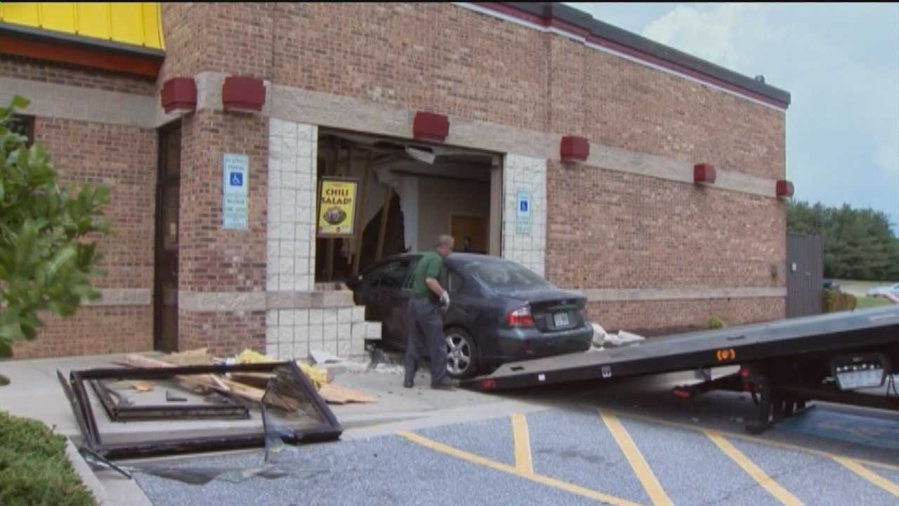 A car crashes into a Wendy's restaurant at 4424 North Woods Trail in Hampstead just before noon Thursday frightening employees and customers alike.