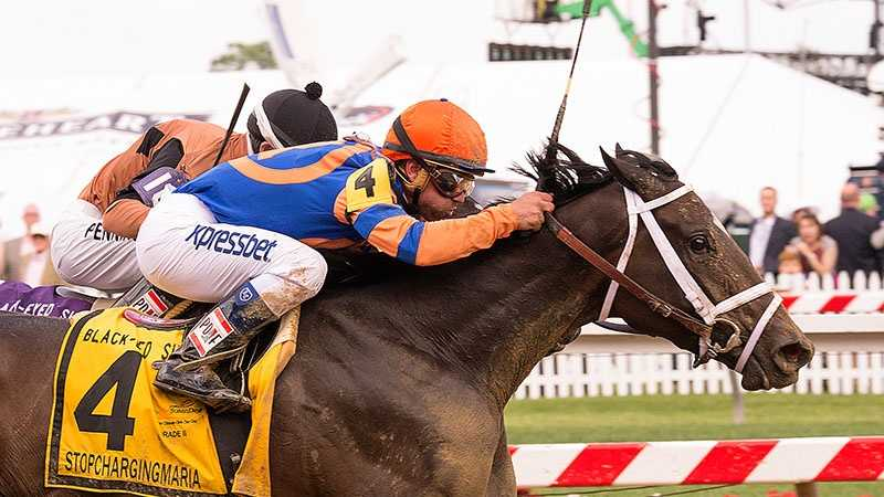 May 16: Repole Stable's Stopchargingmaria takes the overland route and narrowly wins the $500,000 Black-Eyed Susan Stakes (G2) in dramatic fashion.