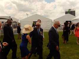Former Secretary of State Colin Powell shaking hands with WBAL-TV 11's Mindy Basara