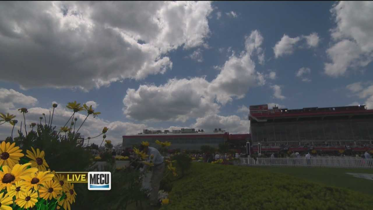 Chief Meteorologist Tom Tasselmyer updates the Preakness forecast as the clouds hover over Pimlico Race Course.