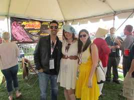 Scott from the 98 Rock Morning Show poses with friends at the 98 Rock tent.