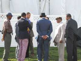 Golden State Warriors star Stephen Curry, former Ravens linebacker Ray Lewis and others watch a magician outside the Under Armour tent.