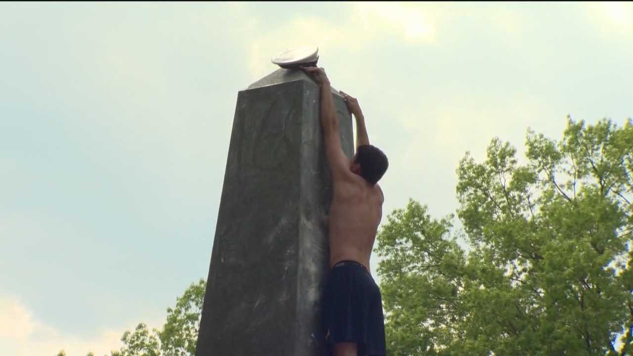 The Naval Academy plebes fight their way up the Herndon Monument trying to be the first to the top. The first one made it in 2 hours, 19 minutes and 35 seconds.