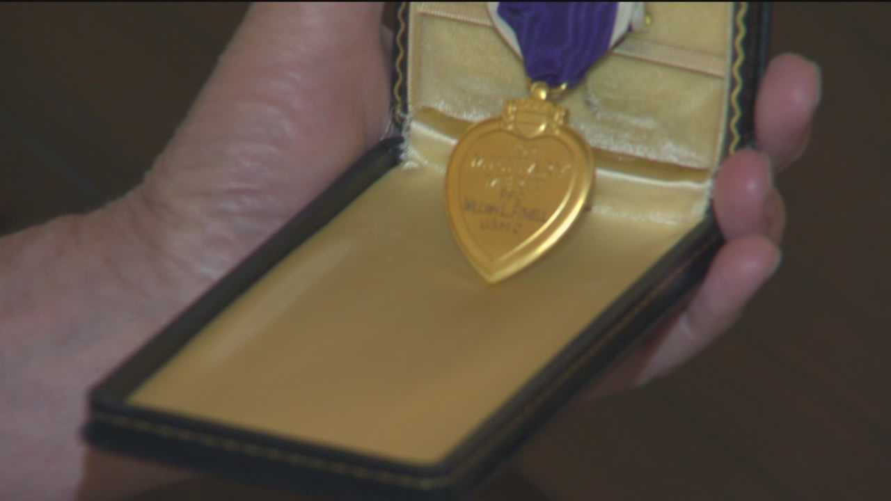 An Owings Mills man is trying to match a Marine's Purple Heart with his family.