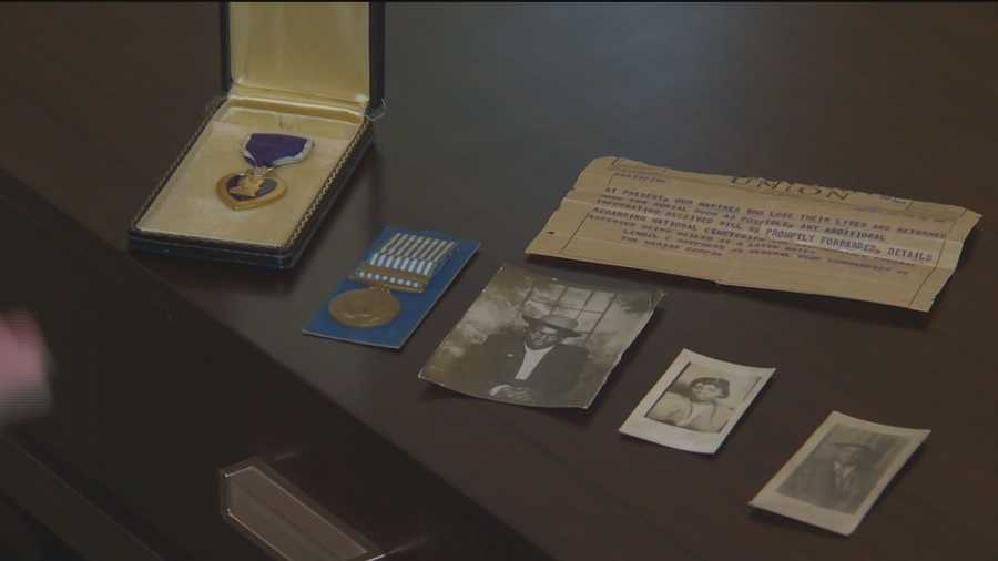 Three photos, a telegram and two medals, including the Purple Heart, were found.