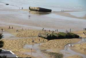 The Invasion of Normandy was the largest air, land and seaborne invasion in history that included more than 5,000 ships, 11,000 airplanes and more than 150,000 servicemen from the U.S., Britain and Canada.