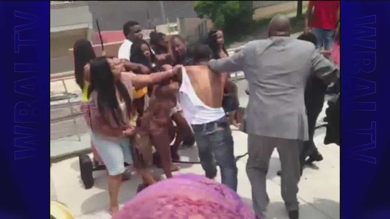 A fight breaks out outside Randallstown High School's 2014 graduation ceremony.