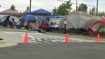 The camping event turned into a community-friendly party that included face painting, music and a bounce house.