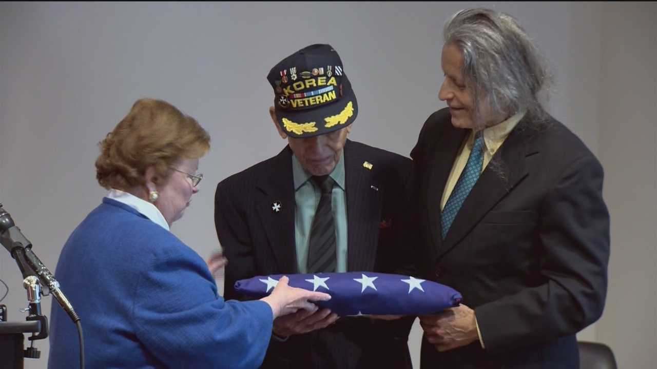 Retired Staff Sgt. Leonardo Martinez, 96, the last living member of the segregated 65th Infantry Regiment, receives honors from Sen. Barbara Mikulski.