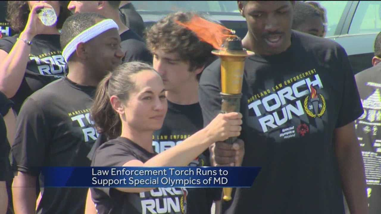 Baltimore City police take part in a 2 1/2 mile torch run around Lake Montebello to help support Special Olympics Maryland.
