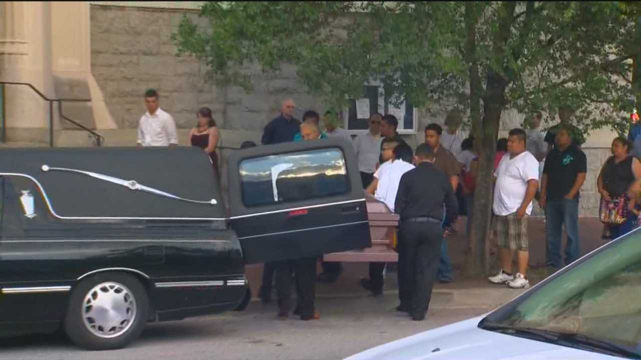 A funeral is held for the 15-year-old boy who was shot and killed by a man who police believe also crashed into a car and killed a 12-year-old girl.