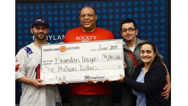 Employees from Rocky's New York Pizza in Cascade claim the $1 million second-tier Powerball prize.